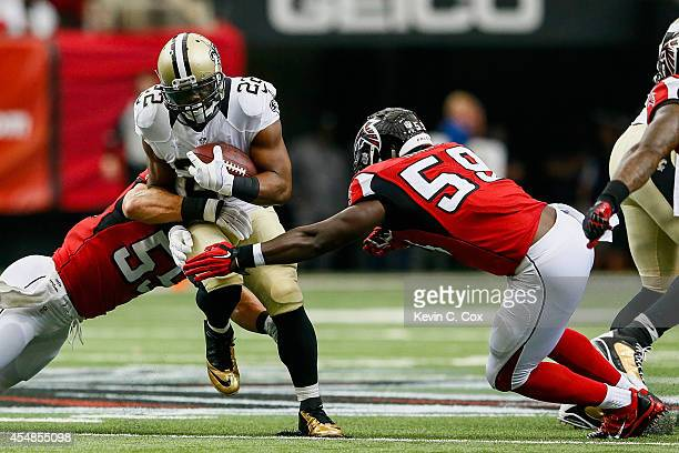 Mark Ingram of the New Orleans Saints is tackled on a run by Paul Worrilow and Joplo Bartu of the Atlanta Falcons in the first quarter against the...