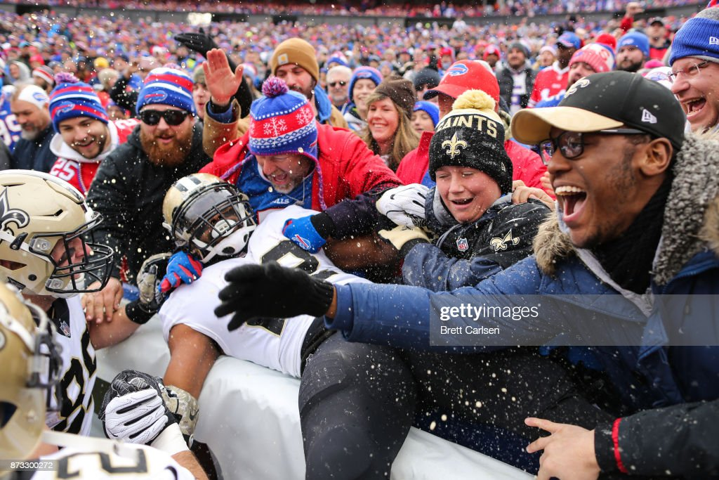 Mark Ingram #22 of the New Orleans Saints jumps into the crowd after scoring a touchdown during the first quarter against the Buffalo Bills on November 12, 2017 at New Era Field in Orchard Park, New York.