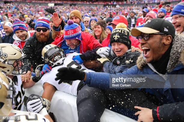 Mark Ingram of the New Orleans Saints jumps into the crowd after scoring a touchdown during the first quarter against the Buffalo Bills on November...