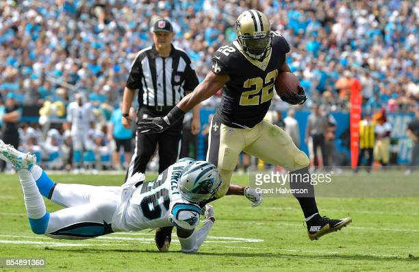 Mark Ingram of the New Orleans Saints runs against Daryl Worley of the Carolina Panthers during their game at Bank of America Stadium on September 24...