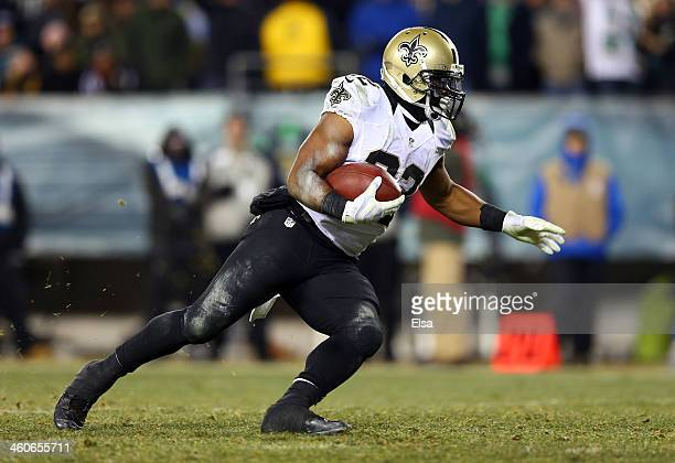 Mark Ingram of the New Orleans Saints runs for a 4 yard touchdown in the third quarter against the Philadelphia Eagles during their NFC Wild Card...