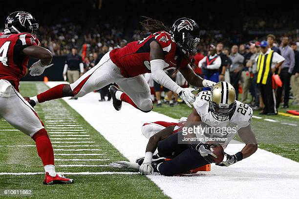 Mark Ingram of the New Orleans Saints runs for a touchdown during the second half of a game against the Atlanta Falcons at the MercedesBenz Superdome...