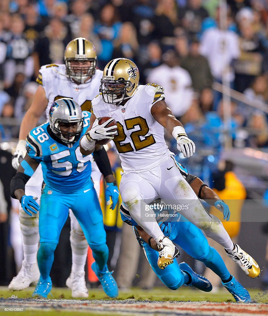 Mark Ingram #22 of the New Orleans Saints runs the ball against Michael Griffin #22 and Thomas Davis #58 of the Carolina Panthers in the third quarter during the game at Bank of America Stadium on November 17, 2016 in Charlotte, North Carolina.