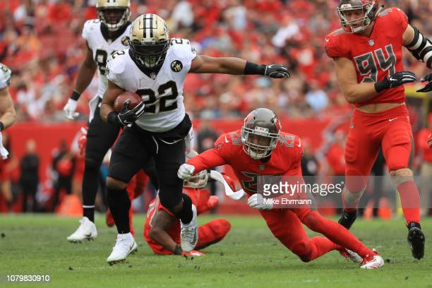 Mark Ingram of the New Orleans Saints runs up the middle for a first down during the third quarter against the Tampa Bay Buccaneers at Raymond James...