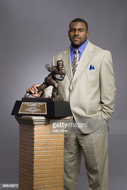 Mark Ingram the 2009 Heisman winner and Alabama running back, poses with his Heisman Trophy on December 13, 2009 in New York City. NOTE TO USER:...