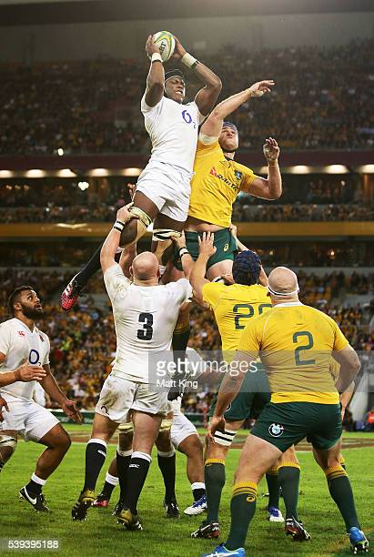 Mark Itoje of England jumps against James Horwill of the Wallabies during the International Test match between the Australian Wallabies and England...