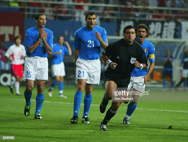 Mark Iuliano Christian Vieri and captain Paolo Maldini of Italy complain to referee Byron Moreno of Ecuador during the FIFA World Cup Finals 2002...