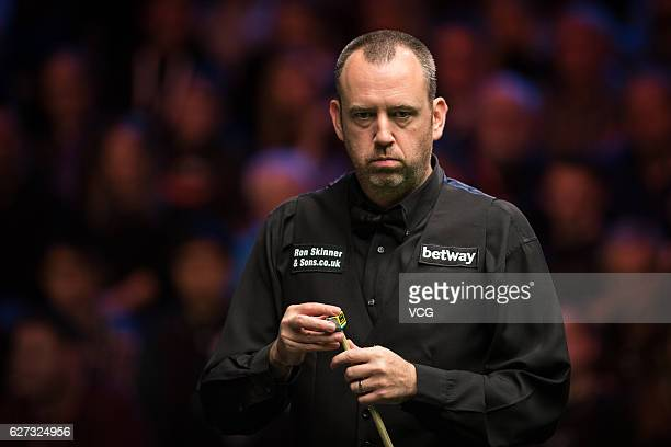 Mark J Williams of Wales chalks the cue during the quarterfinal match against Ronnie O'Sullivan of England on day 11 of Betway UK Championship 2016...