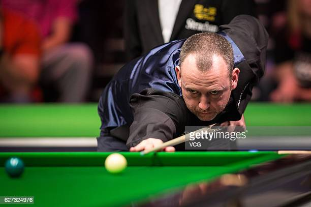Mark J Williams of Wales plays a shot during the quarterfinal match against Ronnie O'Sullivan of England on day 11 of Betway UK Championship 2016 at...