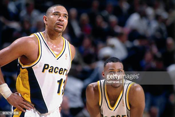 Mark Jackson and Travis Best of the Indiana Pacers looks on during a game played on February 28 1997 at Market Square Arena in Indianapolis Indiana...