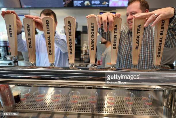 Mark Jackson left and Patrick Nolan with the corporate Dunkin' Donuts Equipment Innovation Department work the brew bar at the new Dunkin' store in...