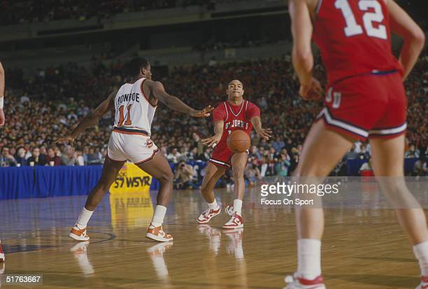 Mark Jackson of St John's passes the ball to a teammate during a game against Syracuse in the 1980s