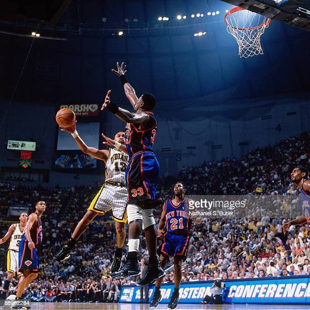 Mark Jackson of the Indiana Pacers makes a pass against Patrick Ewing of the New York Knicks in Game One of the Eastern Conference Finals during the...