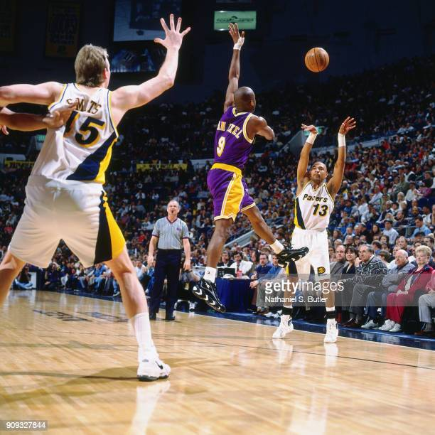 Mark Jackson of the Indiana Pacers passes the ball during a game played on March 2 1997 at Market Square Garden in Indianapolis Indiana NOTE TO USER...