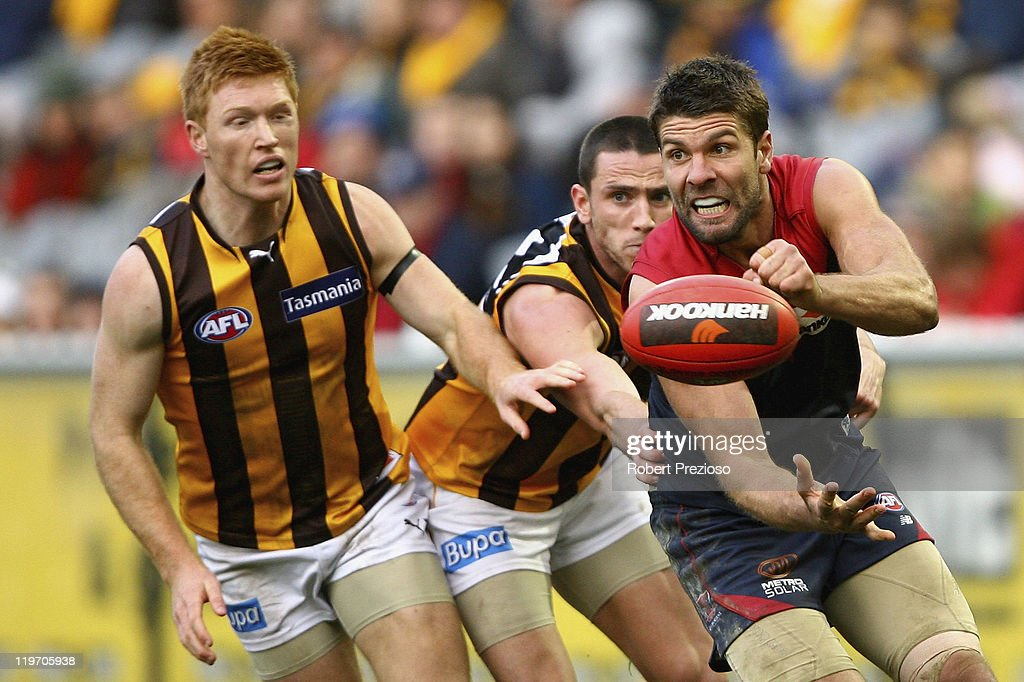 Mark Jamar of the Demons handballs under pressure during the round 18 AFL match between the Melbourne Demons and the Hawthorn Hawks at Melbourne Cricket Ground on July 24, 2011 in Melbourne, Australia.