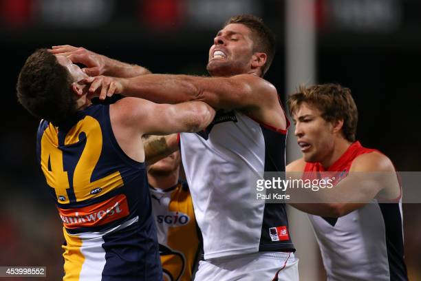 Mark Jamar of the Demons wrestles with Jeremy McGovern of the Eagles during the round 22 AFL match between the West Coast Eagles and the Melbourne...