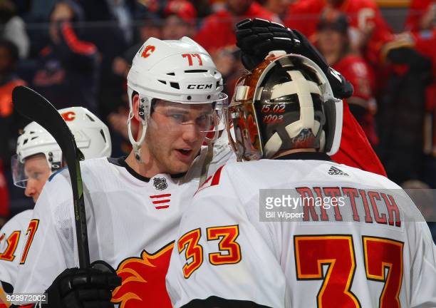 Mark Jankowski and David Rittich of the Calgary Flames celebrate after their 51 victory against the Buffalo Sabres in an NHL game on March 7 2018 at...