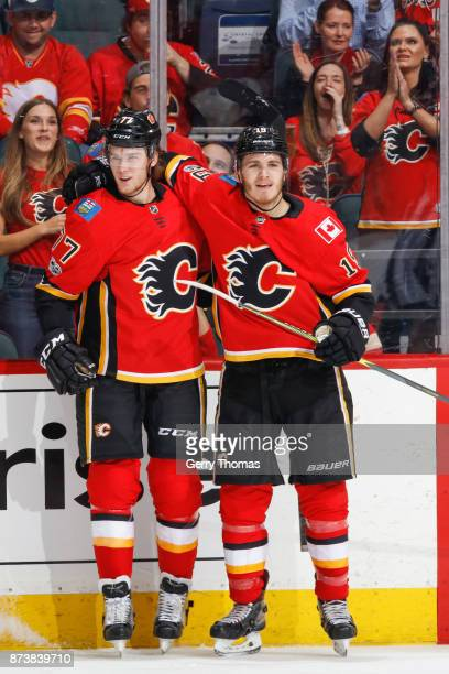 Mark Jankowski and Matthew Tkachuk of the Calgary Flames celebrate in an NHL game against the St Louis Blues at the Scotiabank Saddledome on November...