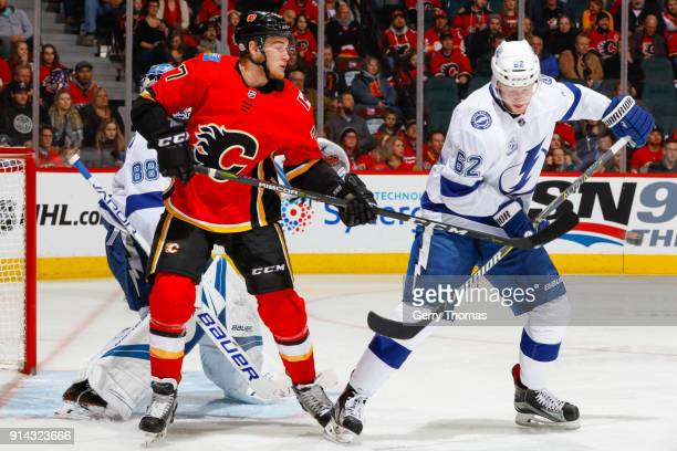 Mark Jankowski of the Calgary Flames and Andrej Sustr of the Tampa Bay Lightning battle for position in an NHL game on February 1 2018 at the...