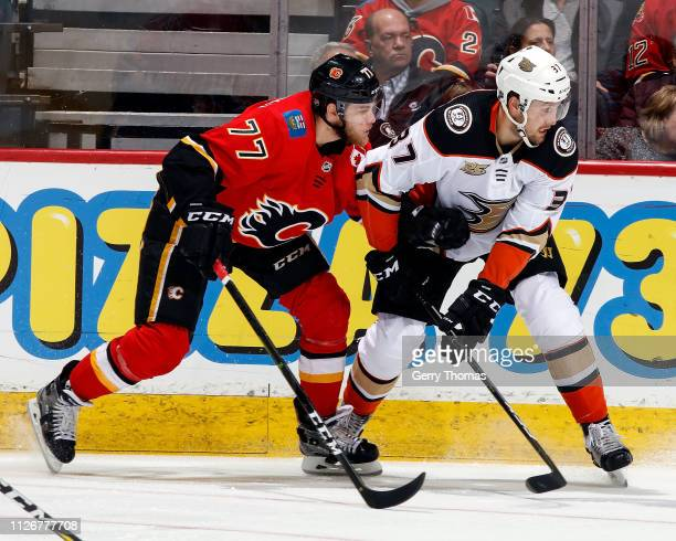 Mark Jankowski of the Calgary Flames and Nick Ritchie of the Anaheim Ducks skate during an NHL game on February 22 2019 at the Scotiabank Saddledome...