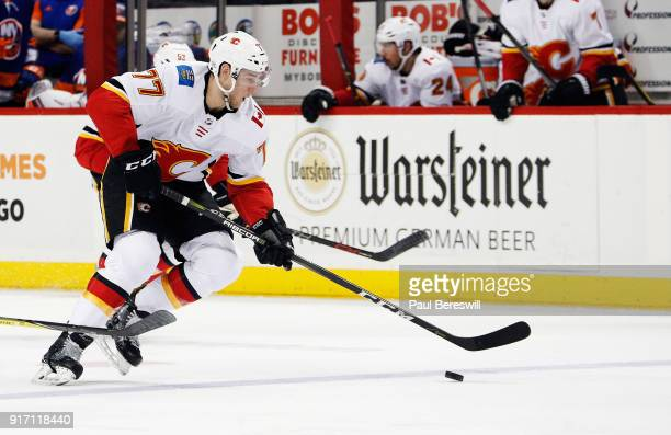 Mark Jankowski of the Calgary Flames carries the puck up ice during the second period against the New York Islanders at Barclays Center on February...