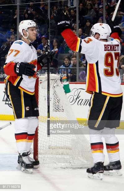 Mark Jankowski of the Calgary Flames celebrates a secondperiod goal against the New York Islanders with teammate Sam Bennett of the Calgary Flames at...