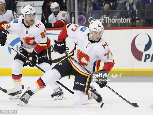 Mark Jankowski of the Calgary Flames drops to his knee playing the puck in an NHL hockey game against the New York Islanders at Barclays Center on...