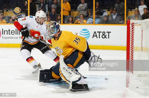 Mark Jankowski of the Calgary Flames scores against Pekka Rinne of the Nashville Predators during an NHL game at Bridgestone Arena on February 15...