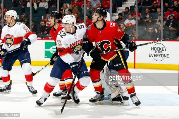 Mark Jankowski of the Calgary Flames skates against MacKenzie Weegar of the Florida Panthers during an NHL game on February 17 2018 at the Scotiabank...