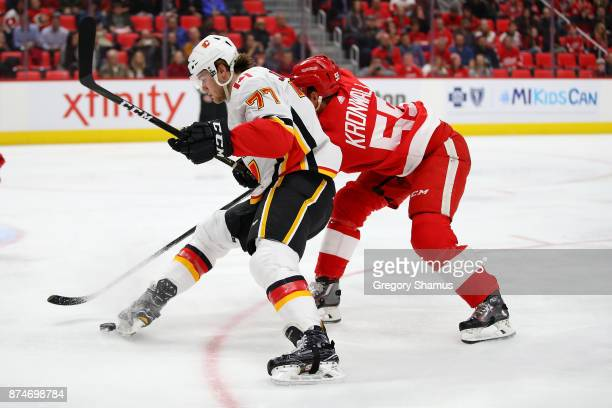 Mark Jankowski of the Calgary Flames tries to control the puck in front of Niklas Kronwall of the Detroit Red Wings during the first period at Little...
