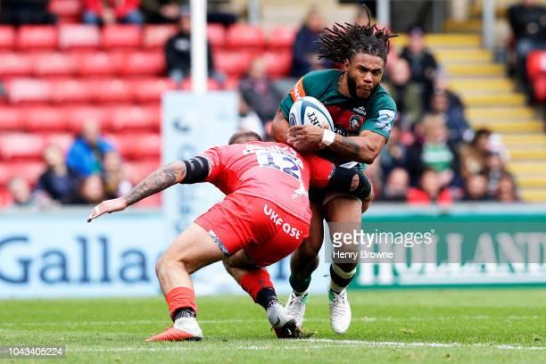 Mark Jennings of Sale Sharks tackles Kyle Eastmond of Leicester Tigers during the Gallagher Premiership Rugby match between Leicester Tigers and Sale...