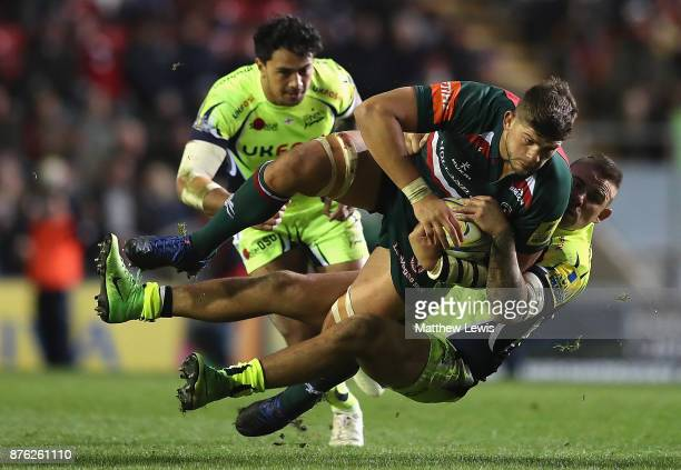 Mark Jennings of Sale Sharks tackles Mike Williams of Leicester Tigers during the Aviva Premiership match between Leicester Tigers and Sale Sharks at...