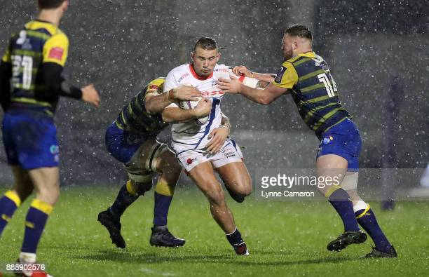 Mark Jennings of Sale Sharks tries to go past James Down and Owen Lane of Cardiff Blues during The European Rugby Challenge Cup match on December 9...
