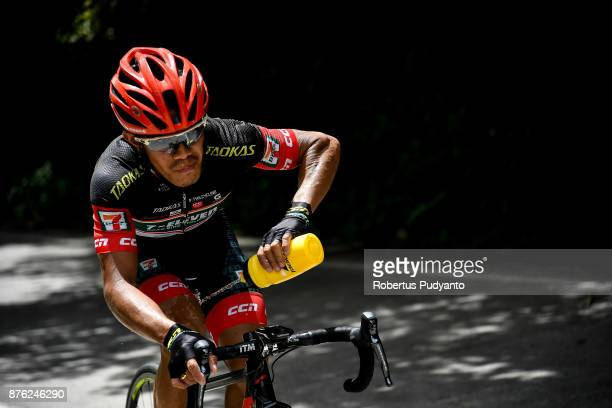 Mark John Lexer Galedo of 7 Eleven Roadbike Philippines sprays his body with water as he compete during stage 2 of the Tour de Singkarak 2017 Pesisir...