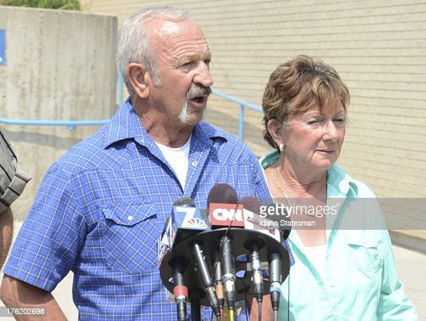 Mark John standing with wife Christa John talk to the media at the Ada County Sheriff's Office in Boise Idaho about their encounters Wednesday with...