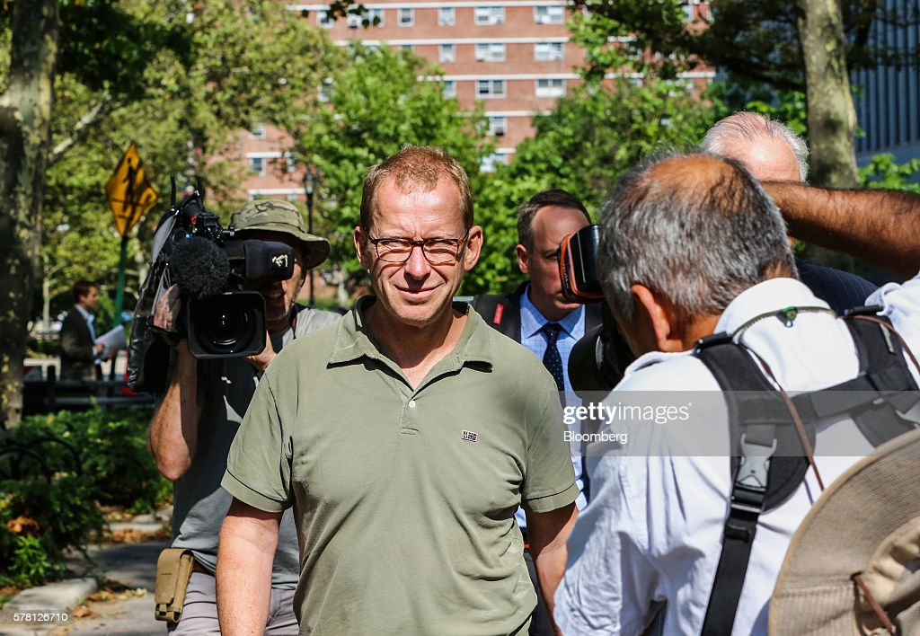 Mark Johnson, global head of foreign exchange cash trading in London HSBC Holdings Plc, center, leaves federal district court in the Brooklyn borough of New York, U.S., on Wednesday, July 20, 2016. Federal agents surprised Johnson as he prepared to fly out of New York's Kennedy airport around 7:30 p.m. Tuesday, arresting him for an alleged front-running scheme involving a $3.5 billion currency transaction in 2011. Photographer: Christopher Goodney/Bloomberg via Getty Images