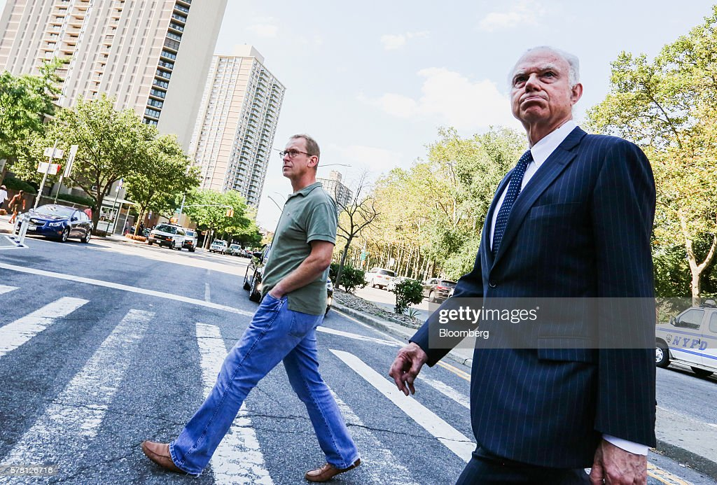 Mark Johnson, global head of foreign exchange cash trading in London HSBC Holdings Plc, left, leaves federal district court in the Brooklyn borough of New York, U.S., on Wednesday, July 20, 2016. Federal agents surprised Johnson as he prepared to fly out of New York's Kennedy airport around 7:30 p.m. Tuesday, arresting him for an alleged front-running scheme involving a $3.5 billion currency transaction in 2011. Photographer: Christopher Goodney/Bloomberg via Getty Images