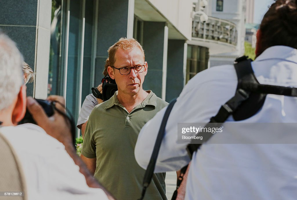Mark Johnson, global head of foreign exchange cash trading in London HSBC Holdings Plc, leaves federal district court in the Brooklyn borough of New York, U.S., on Wednesday, July 20, 2016. Federal agents surprised Johnson as he prepared to fly out of New York's Kennedy airport around 7:30 p.m. Tuesday, arresting him for an alleged front-running scheme involving a $3.5 billion currency transaction in 2011. Photographer: Christopher Goodney/Bloomberg via Getty Images