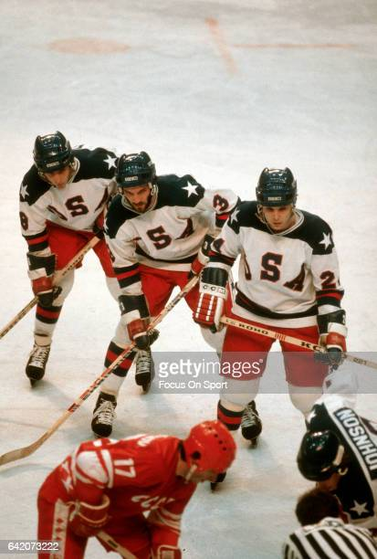 Mark Johnson Ken Morrow Rob McClanahan and Dave Silk of the United States hockey team in action against Valeri Kharlamov of the Soviet Union hockey...