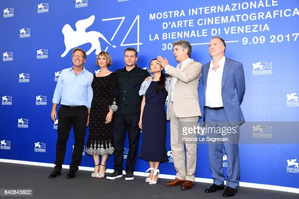 Mark Johnson Kristen Wiig Matt Damon Hong Chau Alexander Payne and Jim Taylor attend the 'Downsizing' photocall during the 74th Venice Film Festival...