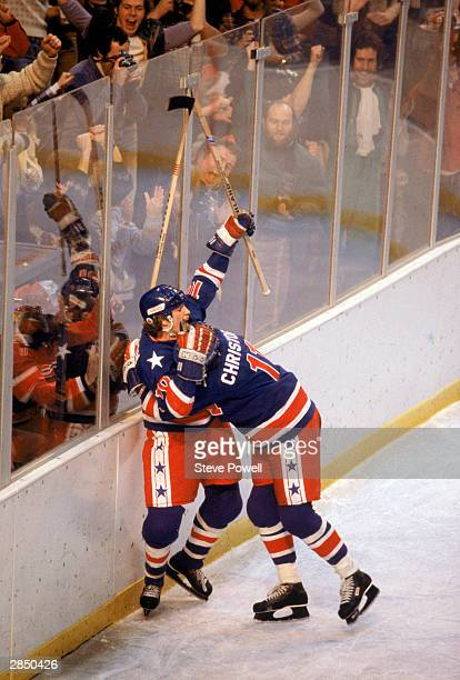 Mark Johnson of the United States hugs teammate Steve Christoff during the Olympic hockey game against Finland on February 24, 1980 in Lake Placid,...