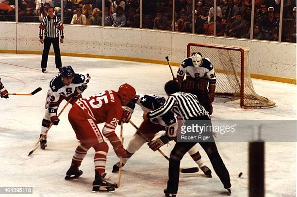 Mark Johnson of the United States wins the faceoff against the Vladimir Golikov of the Soviet Union as Dave Christian and goalie Jim Craig of the USA...