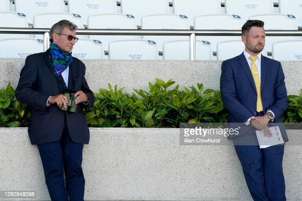 Mark Johnston with his son Charlie Johnston at Goodwood Racecourse on July 30 2020 in Chichester England Owners are allowed to attend if they have a...