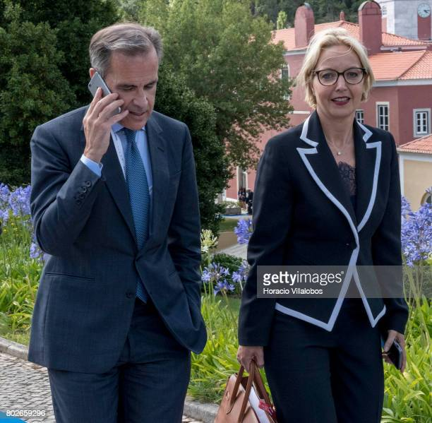 Mark Joseph Carney Governor of the Bank of England and Chairman of the G20's Financial Stability Board engages in a phone call while leaving the...
