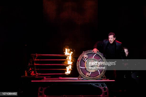 Mark Kalin and Jinger Leigh perform an illusion on stage during a media call for The Illusionists Direct From Broadway at Sydney Opera House on...