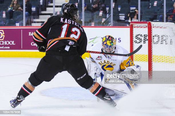 Mark Kastelic of the Calgary Hitmen takes a shot on Nolan Maier of the Saskatoon Blades during a WHL game at the Scotiabank Saddledome on October 28...