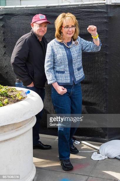 Mark Kelly and Gabrielle Giffords attend the March For Our Lives on March 24 2018 in Washington City