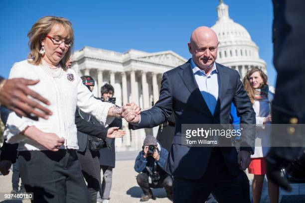 Mark Kelly and his wife former Rep Gabrielle Giffords DAriz are seen after a news conference with lawmakers at the House Triangle to call on Congress...