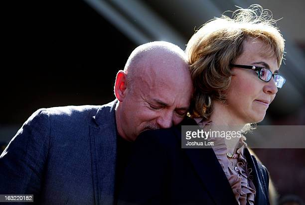 Mark Kelly leans his head on the shoulder of his wife and former Congresswoman Gabby Giffords as they attend a news conference asking Congress and...