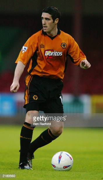 Mark Kennedy of Wolverhampton Wanderers runs with the ball during the Pre-Season Friendly match between Swindon Town and Wolverhampton Wanderers held...